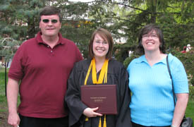 Dad, Me, and Mom in 2008 at my college graduation.