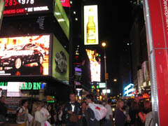 A blurry picture of Times Square at night. Wee!