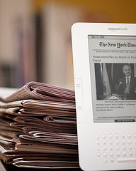 kindle and newspaper